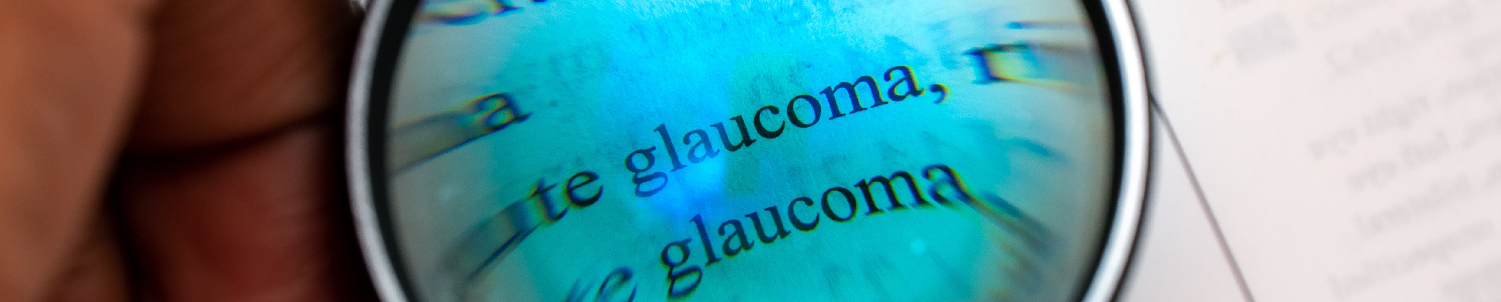 Magnifying glass showing the word glaucoma