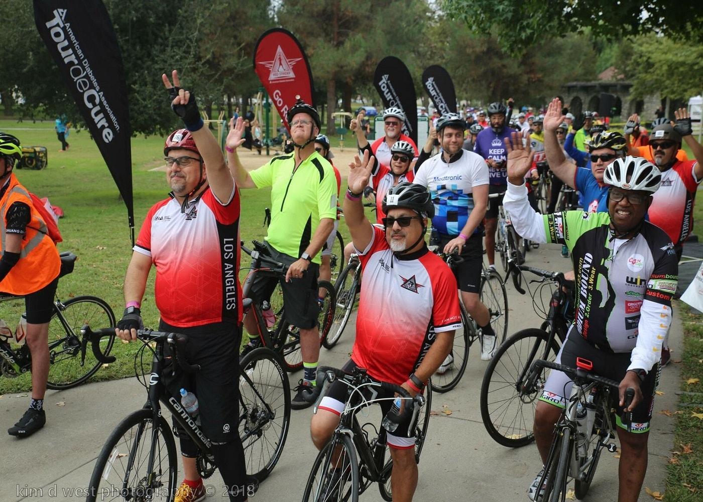 men at tour de cure fundraising event