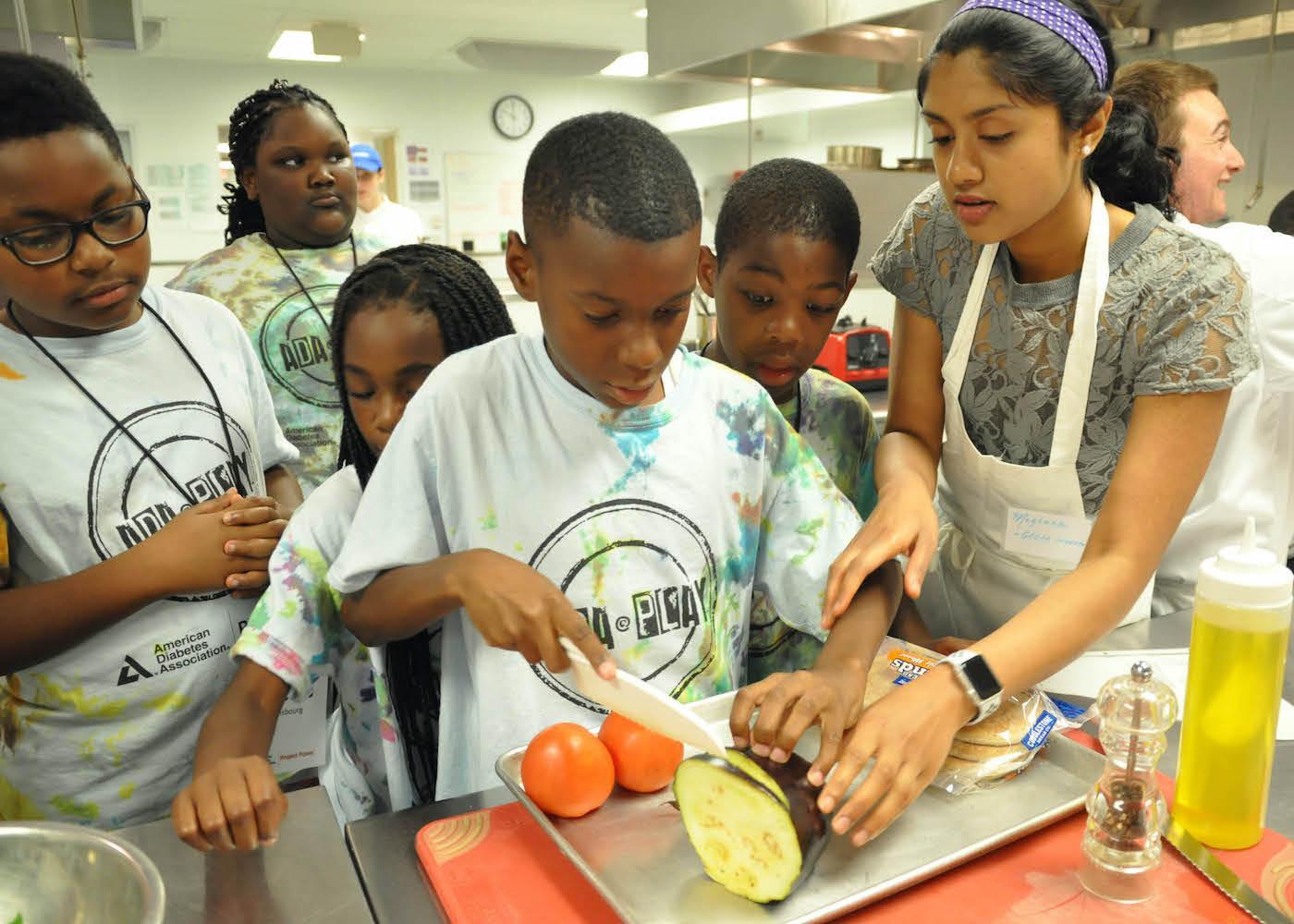 Children cutting vegetables