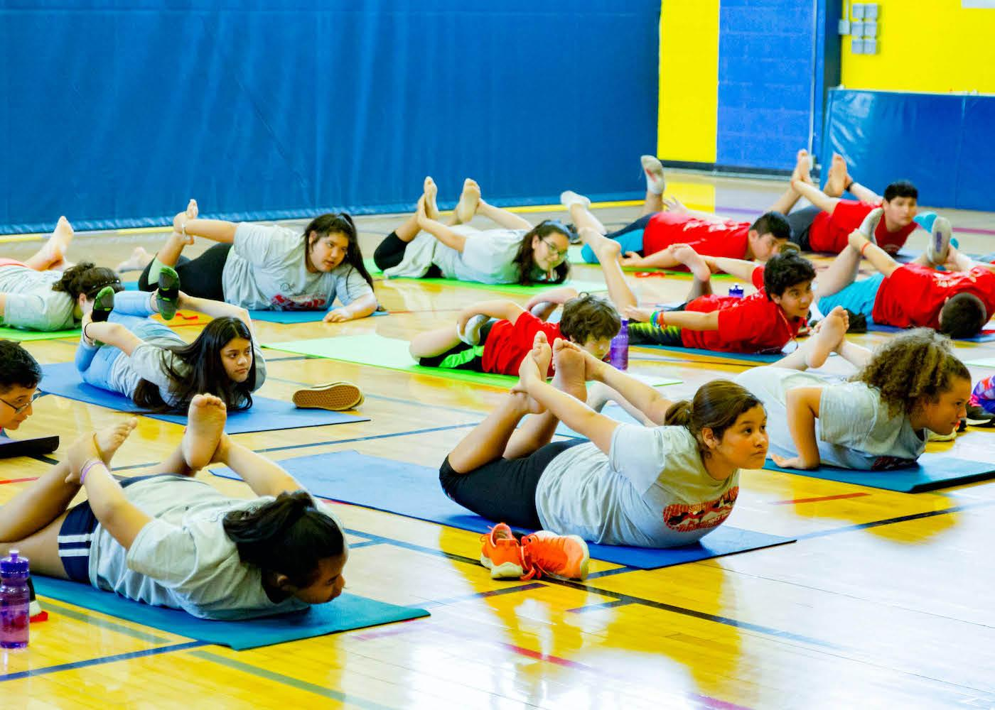 Children exercising on mattresses