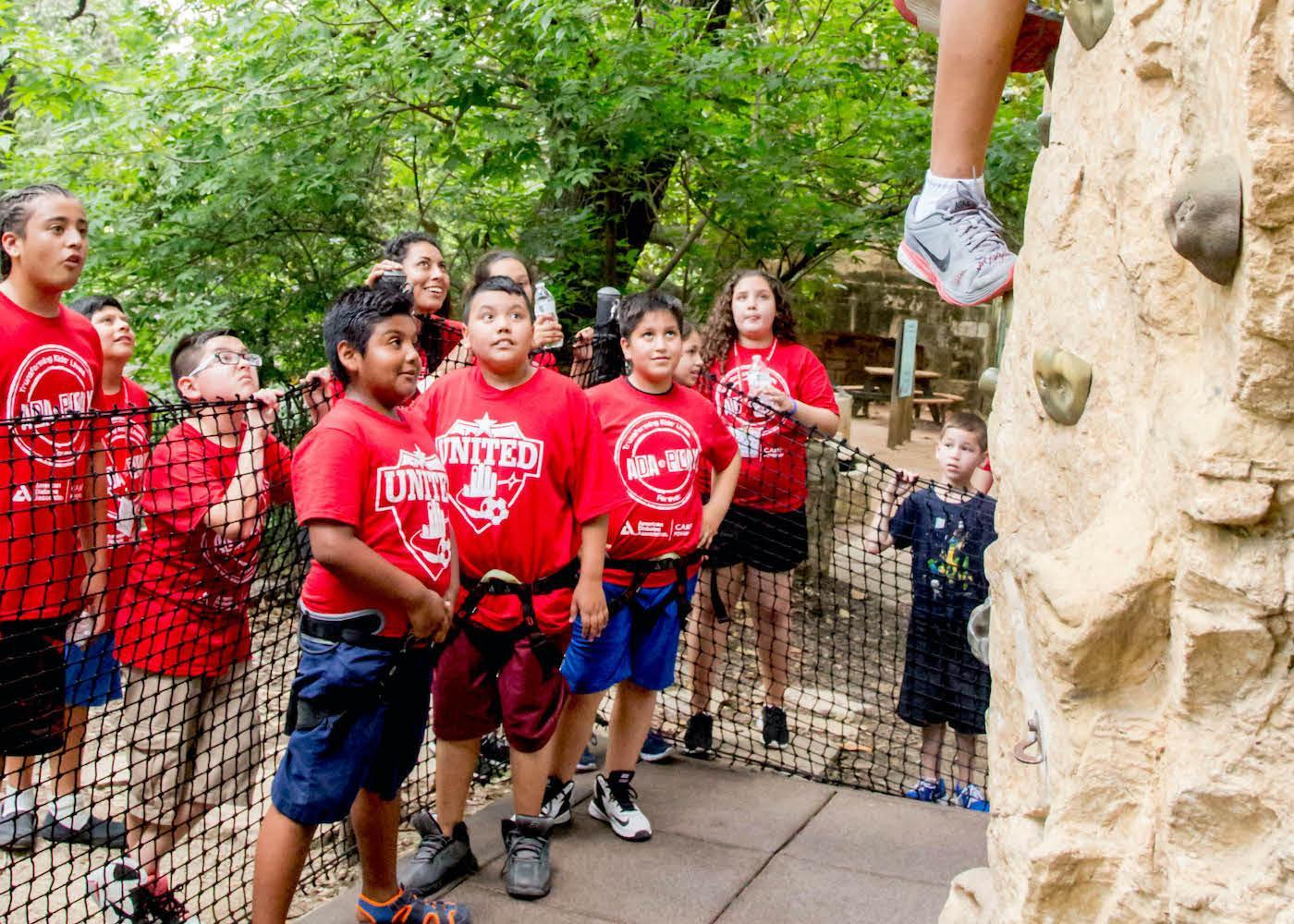 Boys rock climbing