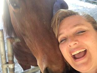 Dianne Bell smiling with horse