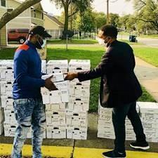 Two men exchanging food boxes