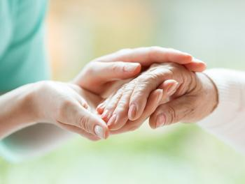 Close-up of younger and older woman holding hands
